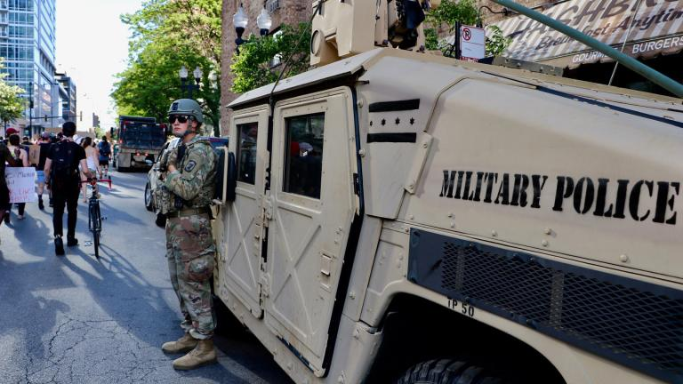 An Illinois National Guard officer watches a protest along Wells Street on June 6, 2020. The march was one of many in the city and across the U.S. sparked by the death of George Floyd while in Minneapolis police custody. (Evan Garcia / WTTW News)