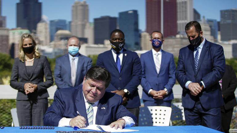 Gov. J.B. Pritzker signs the state's Climate and Equitable Jobs Act at Shedd Aquarium in Chicago on Wednesday, Sept. 15, 2021. (Anthony Vazquez / Chicago Sun-Times via AP)