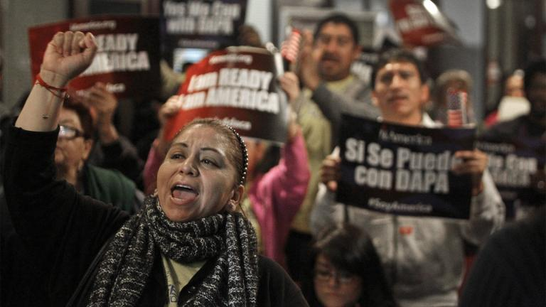 FILE - In this Tuesday, Feb. 17, 2015 file photo, Mercedes Herrera and others chant during an event on DACA and DAPA Immigration Relief at the Houston International Trade Center in Houston. (Melissa Phillip / Houston Chronicle via AP, File)