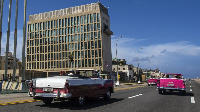 In this Oct. 3, 2017, file photo, tourists ride classic convertible cars on the Malecon beside the United States Embassy in Havana, Cuba. (AP Photo / Desmond Boylan, File)