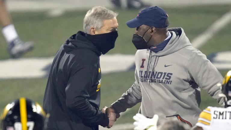 Iowa head coach Kirk Ferentz, left, and Illinois head coach Lovie Smith shakes hands after an NCAA college football game Saturday, Dec. 5, 2020, in Champaign, Ill. Iowa won 35-21. (AP Photo / Charles Rex Arbogast)