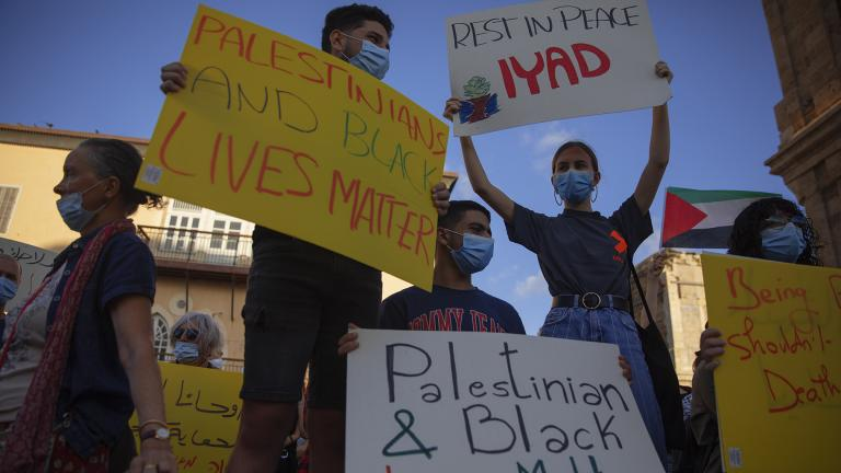 Protesters hold signs during a demonstration against the Israeli police after border police officers shot and killed Iyad al-Halak, an unarmed autistic Palestinian man, in the mixed Arab Jewish city of Jaffa, near Tel Aviv, Israel, after saying they suspected he was carrying a weapon, Sunday, May 31, 2020. Protesters gathered to protest the killing of al-Halak in Jerusalem and the killing of George Floyd in Minneapolis last week. (AP Photo / Oded Balilty)