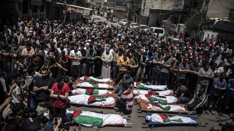 Palestinians attend the funeral of two women and eight children of the Abu Hatab family in Gaza City, who were killed after an Israeli air strike, Saturday, May 15, 2021. (AP Photo / Khalil Hamra)