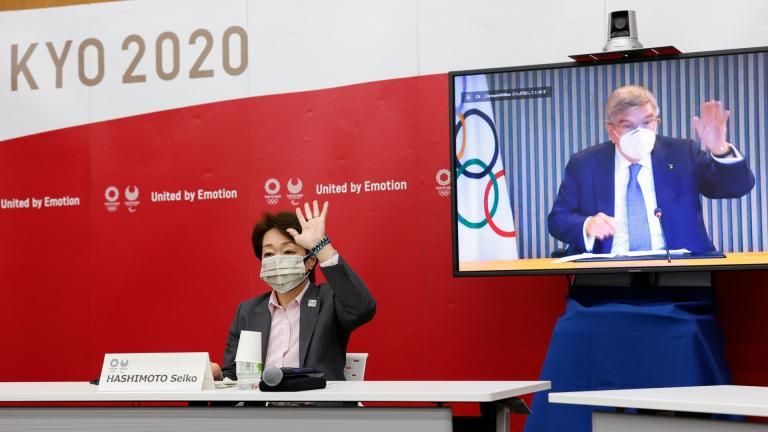 Tokyo 2020 President Seiko Hashimoto and IOC President Thomas Bach, on a screen, greet each other during a five-party online meeting at Harumi Island Triton Square Tower Y in Tokyo Monday, June 21, 2021. (Rodrigo Reyes Marin / Pool Photo via AP)