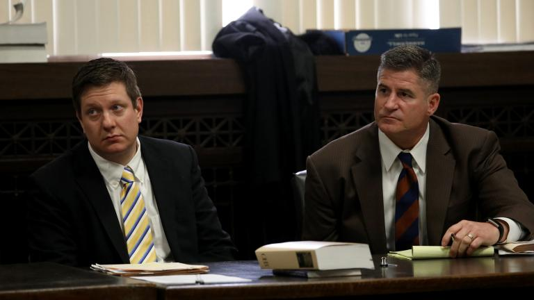 Jason Van Dyke, left, sits with his attorney Daniel Herbert at his hearing at Leighton Criminal Court in Chicago Wednesday April 18, 2018.    (Nancy Stone / Chicago Tribune / Pool)