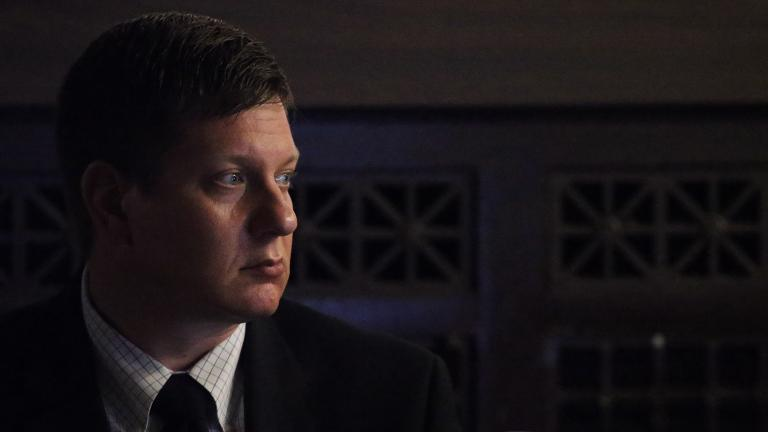 Chicago police Officer Jason Van Dyke listens to court proceedings on Monday, Sept. 17, 2018 as lights are turned off for a video clip. (Antonio Perez / Chicago Tribune / Pool)