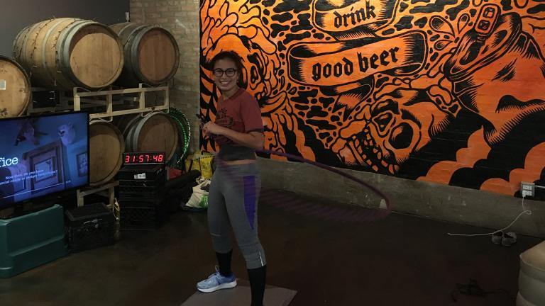 Wicker Park resident Jenny Doan hula-hoops at District Brew Yards. (Kristen Thometz / WTTW News)