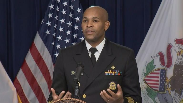U.S. Surgeon General Jerome Adams speaks Tuesday, Dec. 22, 2020 at a press briefing on the coronavirus with Chicago Department of Public Health Commissioner Dr. Allison Arwady and Illinois Department of Public Health Director Dr. Ngozi Ezike. (WTTW News)