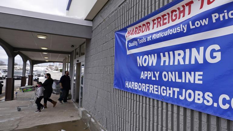 "In this Dec. 10, 2020 file photo, a ""Now Hiring"" sign hangs on the front wall of a Harbor Freight Tools store in Manchester, N.H. (AP Photo/Charles Krupa, File)"