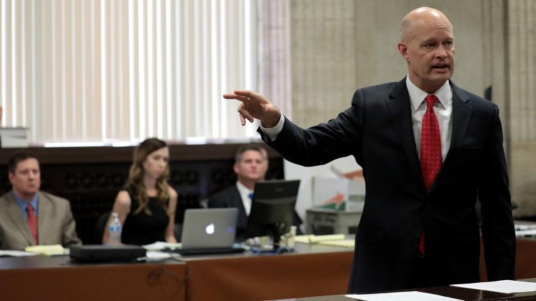 Prosecutor Joseph McMahon delivers closing statements to the jury on Thursday, Oct. 4, 2018 as Chicago police Officer Jason Van Dyke, far left, watches. (Antonio Perez / Chicago Tribune / Pool)