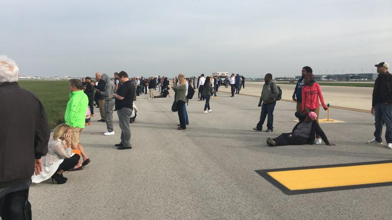 """On Twitter, user Jose Castillo shared this photo and caption after American Airlines Flight 383 caught fire: """"Here's a picture my dad sent me from the runway."""""""