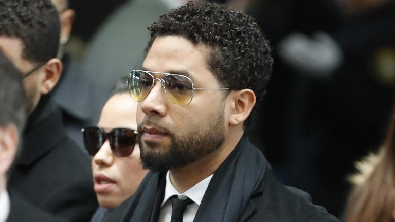 "Former ""Empire"" actor Jussie Smollett, center, arrives for an initial court appearance Monday, Feb. 24, 2020, at the Leighton Criminal Courthouse in Chicago, on a new set of charges alleging that he lied to police about being targeted in a racist and homophobic attack in downtown Chicago early last year.  (AP Photo / Charles Rex Arbogast)"