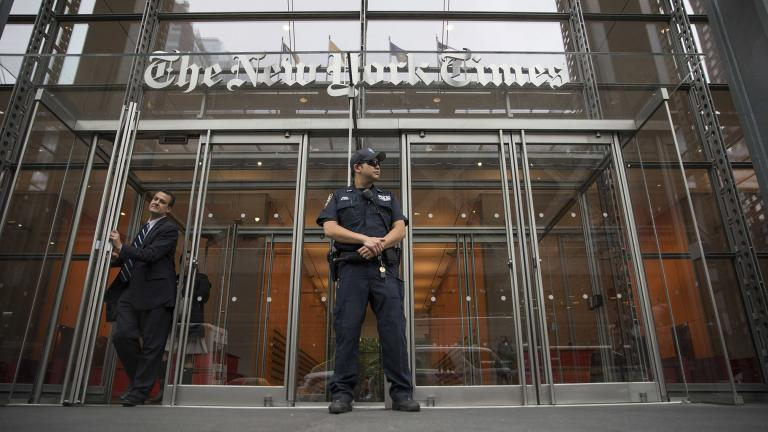 In this June 28, 2018, file photo, a police officer stands outside The New York Times building in New York. (AP Photo / Mary Altaffer, File)