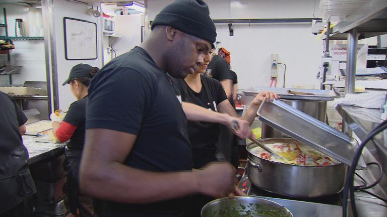 Brandon Johnson works in the kitchen at Chicago restaurant the Girl and the Goat. (Chicago Tonight)