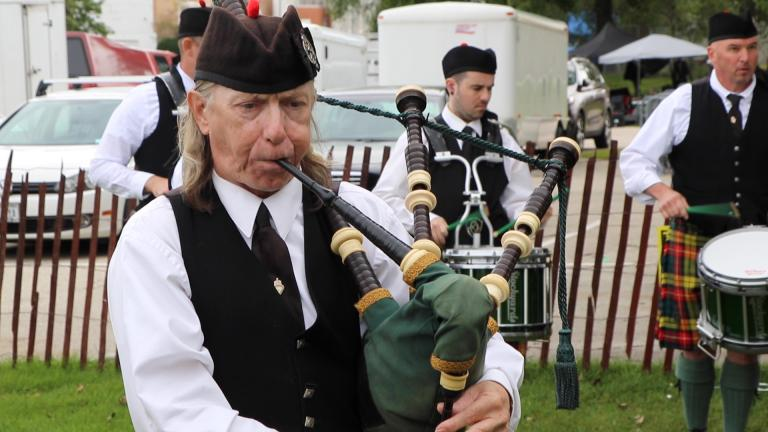 Members of the Chicago Stock Yard Kilty Band rehearse before competing at the Wisconsin Highland games in Waukesha, Wisconsin, on Aug. 31. (Evan Garcia / WTTW News)