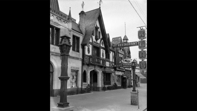 The coats of arms and flourishes like bells and statuettes on the façade of the Klas Restaurant make it feel like something you'd stumble upon in a little village in Eastern Europe. (Courtesy of Chuckman's Collection)