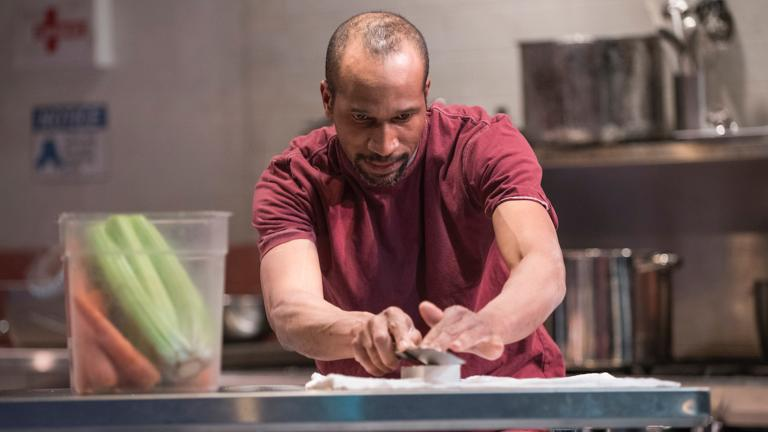 """Anthony Irons in Shattered Globe Theatre's Chicago premiere of """"How to Use a Knife."""" (Photo by Michael Brosilow)"""