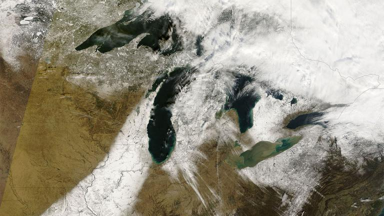 Streaks of snow stretching across the Great Lakes captured by a NASA satellite on Dec. 9, 2006. (NASA)