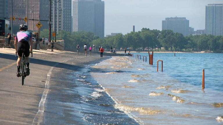 Lake Michigan waves cover Chicago's lakefront path in the summer of 2019. (WTTW News)