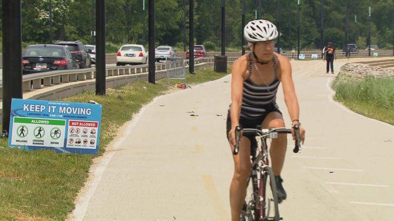 A cyclist rides along the lakefront trail on its official reopening day, Monday, June 22, 2020. (WTTW News)