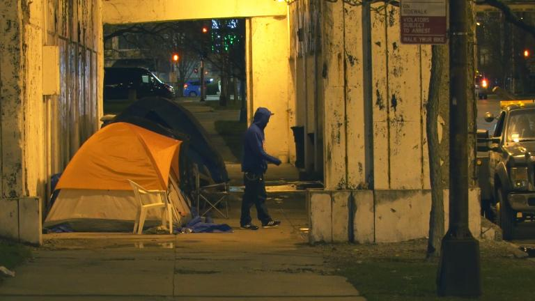 A number of tents line the Lawrence Avenue underpass on a winter night in 2016. (Chicago Tonight)