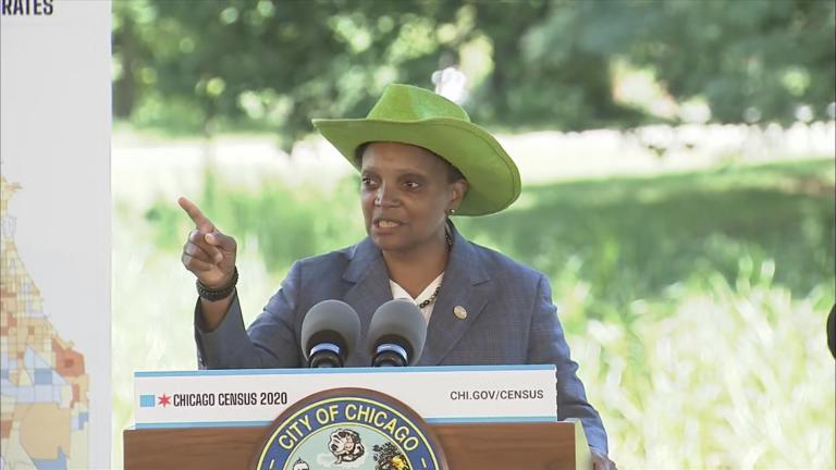 Mayor Lori Lightfoot dons a bright green cowboy hat before introducing a special guest — and his 13-year-old horse — at a press conference Monday, July 13, 2020. (WTTW News)