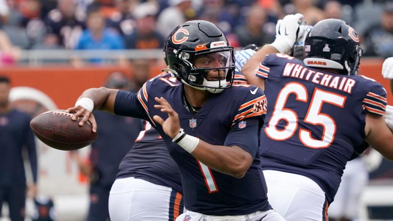 Chicago Bears quarterback Justin Fields passes during the first half of an NFL football game against the Detroit Lions Sunday, Oct. 3, 2021, in Chicago. (AP Photo / David Banks)