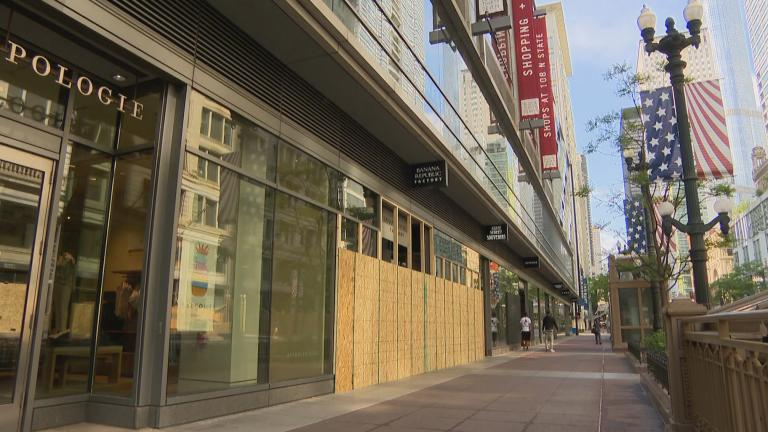 Boarded-up storefronts in the Loop on Monday, June 1, 2020 show damage caused by looting over the weekend. (WTTW News)