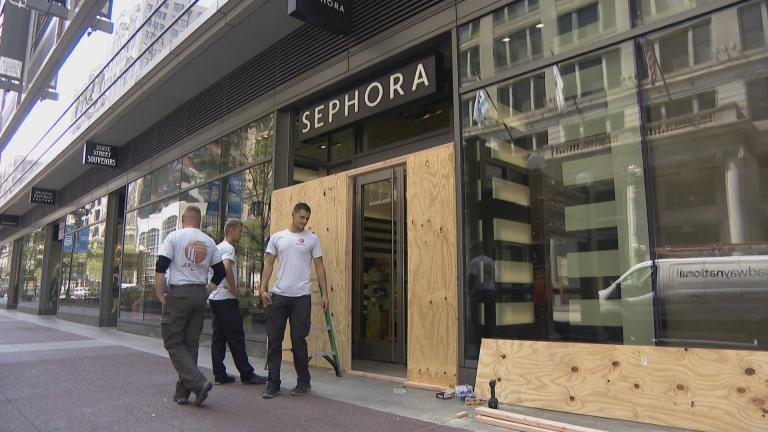 Windows at a Sephora in downtown Chicago are boarded up following looting on Sunday, Aug. 9, 2020. (WTTW News)
