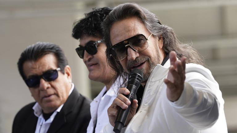 Members of the Mexican grupera band Los Bukis, from left, Pedro Sanchez, Roberto Guadarrama and Marco Antonio Solis attend a press conference at SoFi Stadium on Monday, June 14, 2021, in Inglewood, Calif. (AP Photo / Chris Pizzello)