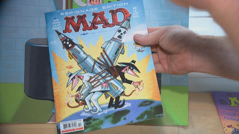 Cartoonist Johnny Sampson showcases an issue of Mad Magazine on Aug. 6, 2021. (WTTW News)