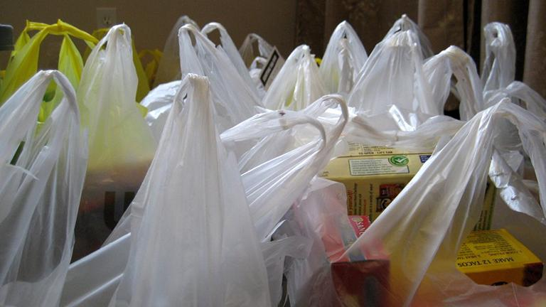 Starting Aug. 1, 2016, chain stores that are 10,000 square feet or less must comply with the city's plastic bag ban originally enacted a year ago. (MTSOfan / Flickr)