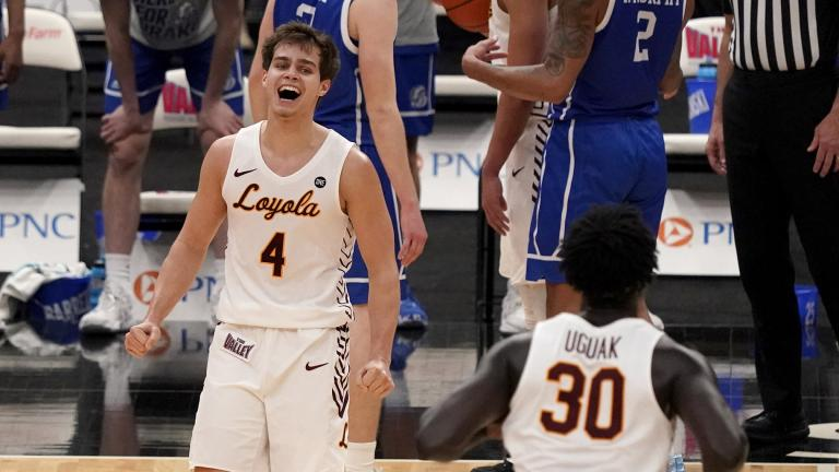 Loyola of Chicago's Braden Norris (4) and teammate Aher Uguak (30) celebrate a 75-65 victory over Drake during the championship game in the NCAA Missouri Valley Conference men's basketball tournament Sunday, March 7, 2021, in St. Louis. (AP Photo / Jeff Roberson)