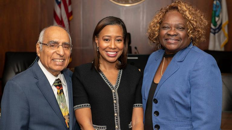 Newly elected MWRD President Kari Steele (center) with Finance Chairman Frank Avila and Vice President Barbara McGowan (Metropolitan Water Reclamation District of Greater Chicago)