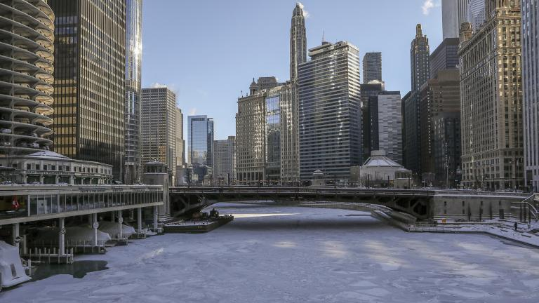 Ice covers the Chicago River on Wednesday, Jan. 30, 2019. A deadly arctic deep freeze enveloped the Midwest with record-breaking temperatures triggering widespread closures of schools and businesses. (AP Photo / Teresa Crawford)
