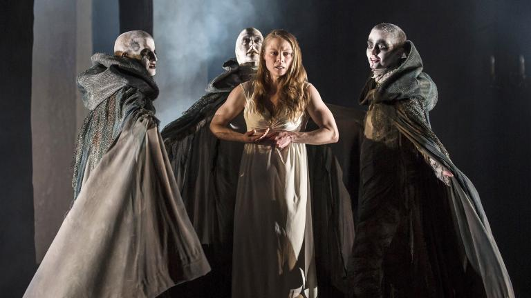 """Lady Macbeth (Chaon Cross) is taunted by the unseen Weird Sisters in Chicago Shakespeare Theater's production of """"Macbeth."""" (Photo by Liz Lauren)"""