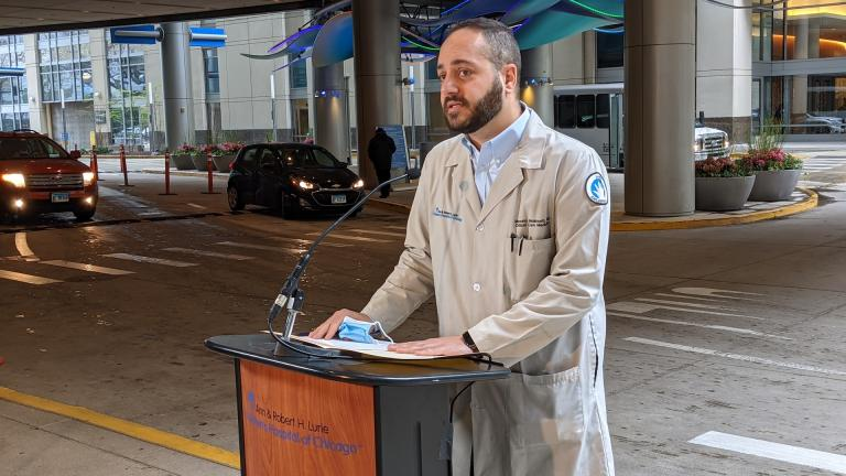 Dr. Marcelo Malakooti, medical director at Lurie Children's Hospital, provides an update to reporters on Monday, April 19 outside the hospital on the condition of 22-month-old Kayden Swann, who was shot April 6. (Matt Masterson / WTTW News)