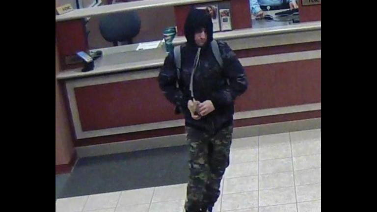 Surveillance footage shows the suspect in three Chicago bank robberies. Authorities believe that man is Matthew Silberman. (FBI)