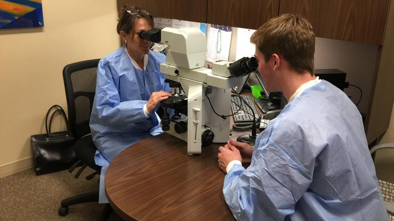 Pathologist Dr. Wendy Ward, left, and Zack Whitaker in the laboratory at Northwestern Medicine Huntley Hospital. (Courtesy of Northwestern Medicine)
