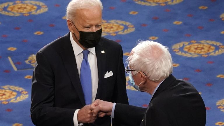 FILE - In this April 28, 2021 file photo, President Joe Biden greets Sen. Bernie Sanders, I-Vt., as Biden arrives to speak to a joint session of Congress in the House Chamber at the U.S. Capitol in Washington. (AP Photo / Andrew Harnik, Pool)