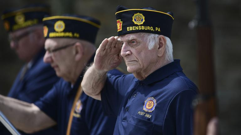 U.S. Army veteran Joseph Lesniak of Colver, Pa., salutes during the playing of Taps at a Memorial Day ceremony at Soldiers and Sailors Memorial Park, in Ebensburg, Pa., Monday, May 25. 2020. (John Rucosky / The Tribune-Democrat via AP)