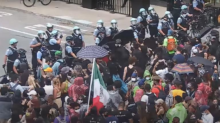A still image taken from a video released by the Chicago Police Department shows a confrontation between protesters and police at Michigan Avenue and Wacker Drive on Saturday, Aug. 15, 2020. (WTTW News via CPD)
