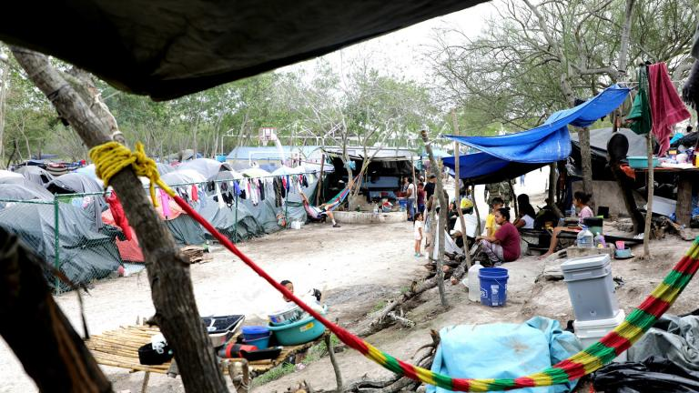 A migrant camp in Matamoros, Mexico, where thousands of asylum-seekers have been living for months as they wait for their court hearings. The camp is without running water or working toilets. (Credit: Maria Ines Zamudio)