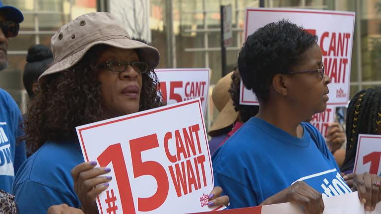 Labor activists join some public officials downtown for a rally in support of raising the minimum wage in August 2019. (WTTW News)
