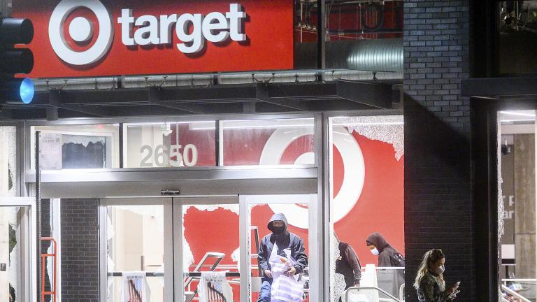 People leave a vandalized Target store in Oakland, Calif., on Saturday, May 30, 2020, during protests against the death of George Floyd, a handcuffed black man in police custody in Minneapolis. (AP Photo / Noah Berger)
