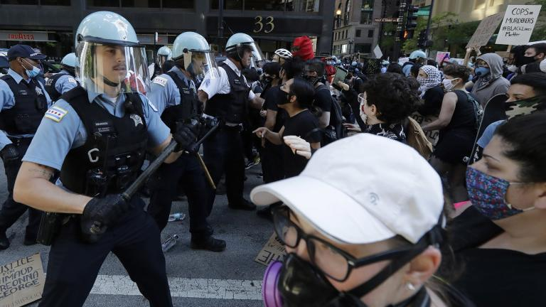 Chicago Police officers and protesters clash during a protest over the death of George Floyd in Chicago, Saturday, May 30, 2020. Floyd died after being taken into custody and restrained by Minneapolis police on Memorial Day in Minnesota. (AP Photo / Nam Y. Huh)