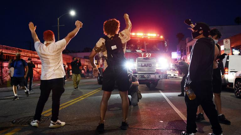 Demonstrators block the path of a Los Angeles Fire Department truck during a public disturbance on Melrose Avenue, Saturday, May 30, 2020, in Los Angeles. (AP Photo / Chris Pizzello)