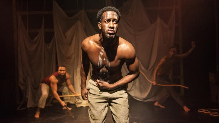 "David Goodloe, center, with Lewon Johns, back left, and Michael Turrentine in Griffin Theatre Company's Midwest premiere of ""Mlima's Tale."" (Photo by Michael Brosilow)"