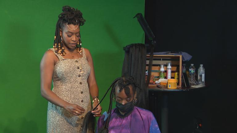 """""""People would cancel their braid appointment if they had an interview,"""" Mo G said. """"I would always say, 'That's not the job that you want. Go to your interview with your braids, it's okay."""" (WTTW News)"""