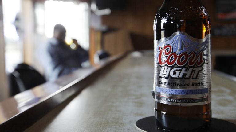 In this Monday, May 4, 2009, file photo, a bottle of Coors Light sits on the bar as a patron sips a beer at a tavern in Blue Island, Ill. (AP Photo / M. Spencer Green, File)